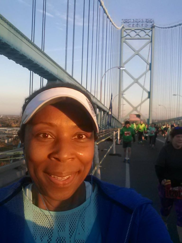Pausing for a photo on the Ambassador Bridge (en route to Canada) while running my 1st half marathon